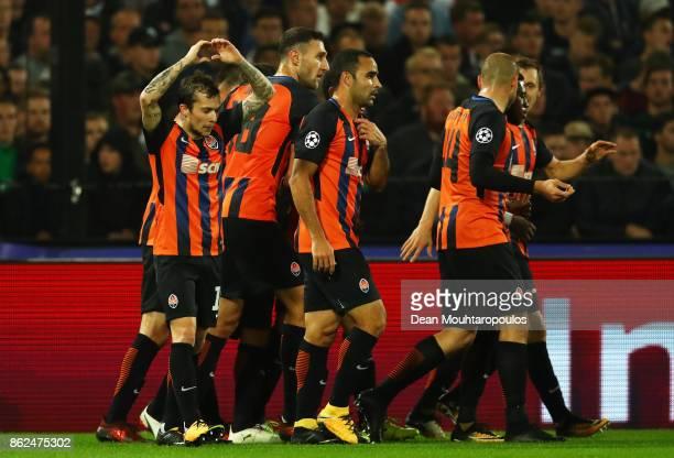 Bernard of Shakhtar Donetsk celebrates scoring his sides first goal with his Shakhtar Donetsk team mates during the UEFA Champions League group F...