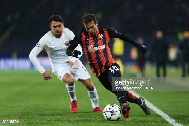 Bernard of Shakhtar Donetsk gets away from Cengiz Under of AS Roma places the ball during the UEFA Champions League Round of 16 First Leg match...