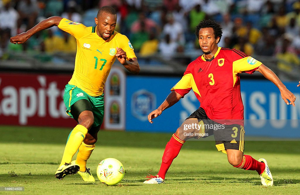 Bernard Parker of South Africa and Antonio Luis dos Santos Serrado of Angola during the 2013 African Cup of Nations match between South Africa and Angola from Moses Mabhida Stadium on January 23, 2012 in Durban, South Africa.