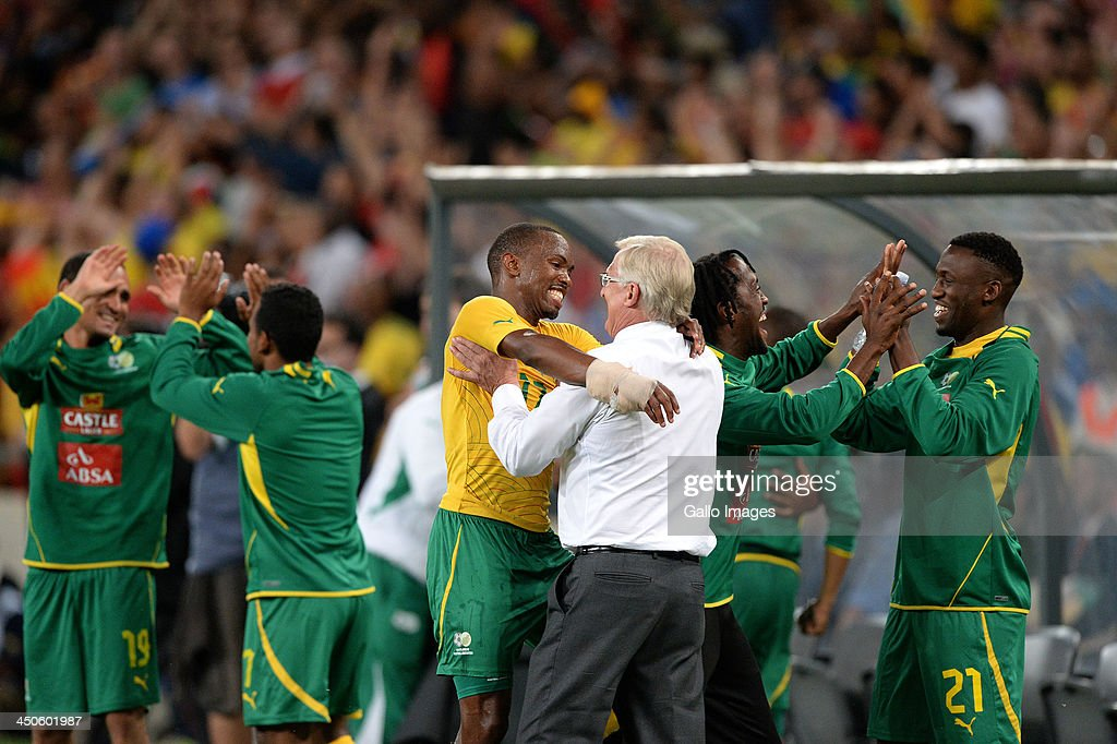 Bernard Parker of South Africa celebrates with manager Gordon Igesund at the final whistle during the International friendly match between South Africa and Spain at Soccer City Stadium on November 19, 2013 in Johannesburg, South Africa.