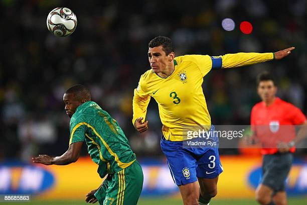 Bernard Parker of South Africa is beaten to the ball with Lucio of Brazil during the FIFA Confederations Cup Semi Final match beween Brazil and South...