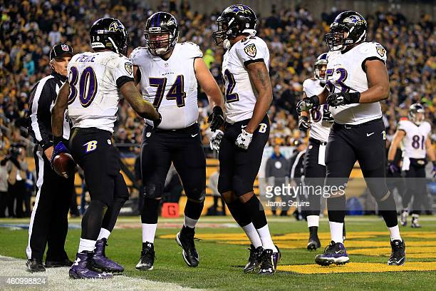 Bernard Pierce of the Baltimore Ravens celebrates with teammates after scoring a touchdown in the second quarter against the Pittsburgh Steelers...