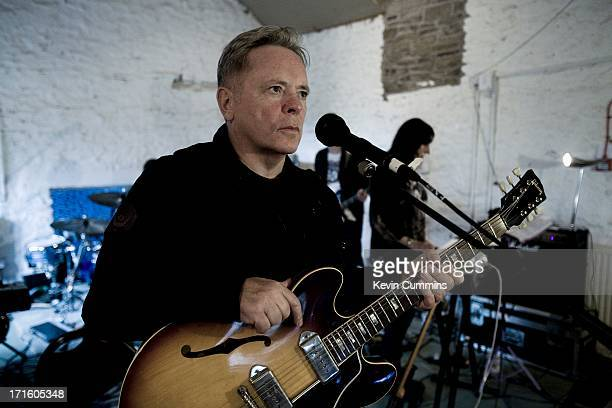 Bernard Sumner and Gillian Gilbert of New Order in the band's rehearsal studio UK 22nd September 2011 Sumner is playing a Gibson ES330 guitar