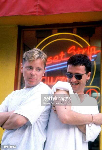 Bernard Sumner and Johnny Marr of the band Electronic pose for a portrait outside a tattoo parlour on Sunset Strip Los Angeles USA August 1990 Johnny...