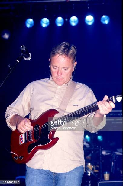 Bernard Sumner of New Order performs on stage at Brixton Academy London in October 2001
