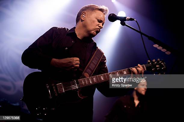 Bernard Sumner of New Order performs on stage at Le Bataclan on October 18 2011 in Paris France