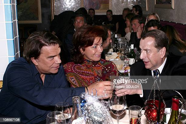 Bernard Tapie and wife Dominique with PaulLoup Sulitzer in Paris France on October 21st 2004