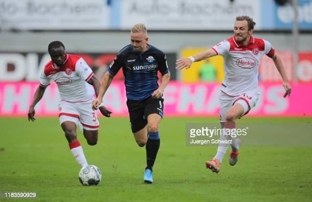 Bernard Tekpetey of Duesseldorf Kai Proeger of Paderborn and Adam Bodzek of Duesseldorf battle for the ball during the Bundesliga match between SC...