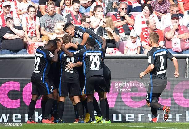 Bernard Tekpetey of Paderborn celebrates after scoring his team`s fourth goal with team mates during the Second Bundesliga match between 1 FC Koeln...