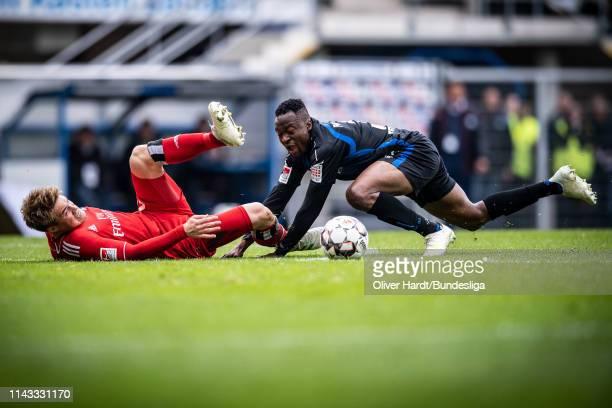 Bernard Tekpetey of SC Paderborn challenges for the ball with Gotoku Sakai of Hamburger SV during the Second Bundesliga match between SC Paderborn...