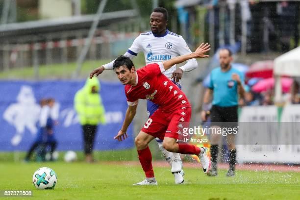 Bernard Tekpetey of Schalke battle for the ball during the preseason friendly match between FC Schalke 04 and Neftchi Baku on July 26 2017 in...