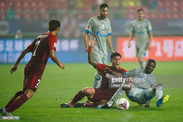 Bernard Tekpetey of Schalke in action with Ren Hang of China Fortune during the 2018 Clubs Super Cup match between FC Schalke 04 and China Fortune at...