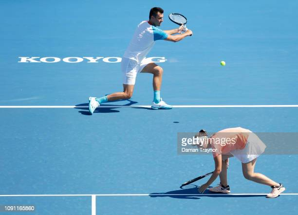 Bernard Tomic and Sara Tomic of Australia play mixed doubles against John Peers and Sally Peers of Australia during day one of the 2019 Kooyong...