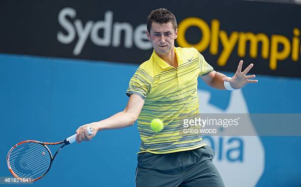 Bernard Tomic from Australia hits a return during his semi-final match with Sergiy Stakhovsky of the Ukraine at the APIA Sydney International tennis...