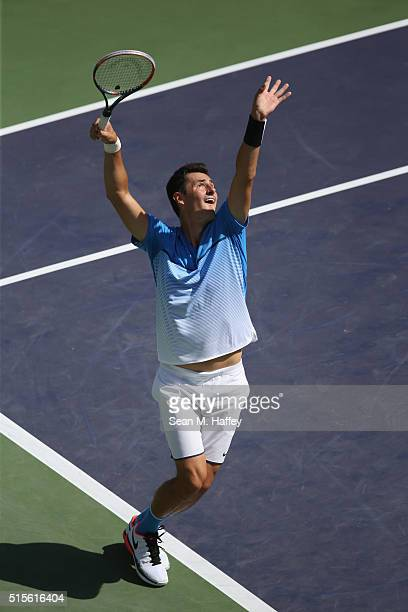 Bernard Tomic of Austrailia serves against Milos Raonic of Canada during the BNP Paribas Open at the Indian Wells Tennis Garden on March 11 at Indian...
