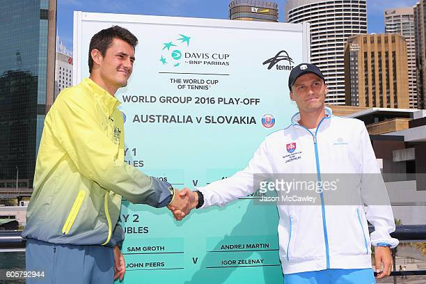 Bernard Tomic of Australia and Josef Kovalik of Slovakia shake hands during the Davis Cup World Group Playoff Australia v Slovakia Official Draw at...