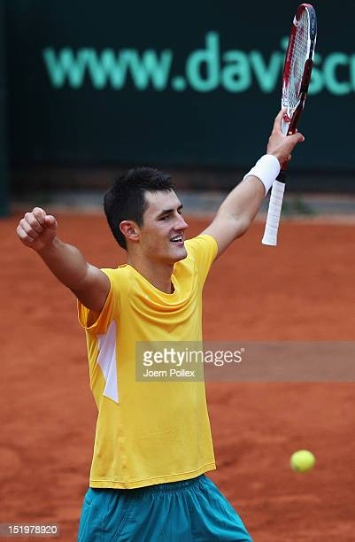 Bernard Tomic of Australia celebrates after winning his match against CedrikMarcel Stebe of Germany during the Davis Cup World Group PlayOff match...