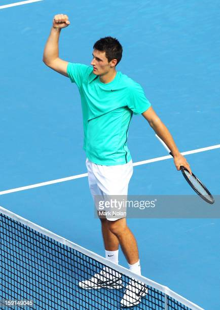 Bernard Tomic of Australia celebrates his win in his second round match over Florian Meyer of Germany during day four of the Sydney International at...