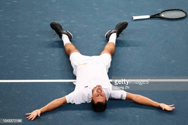 Bernard Tomic of Australia celebrates winning his final match against Fabio Fognini of Italy during 2018 ATP World Tour Chengdu Open at Sichuan...