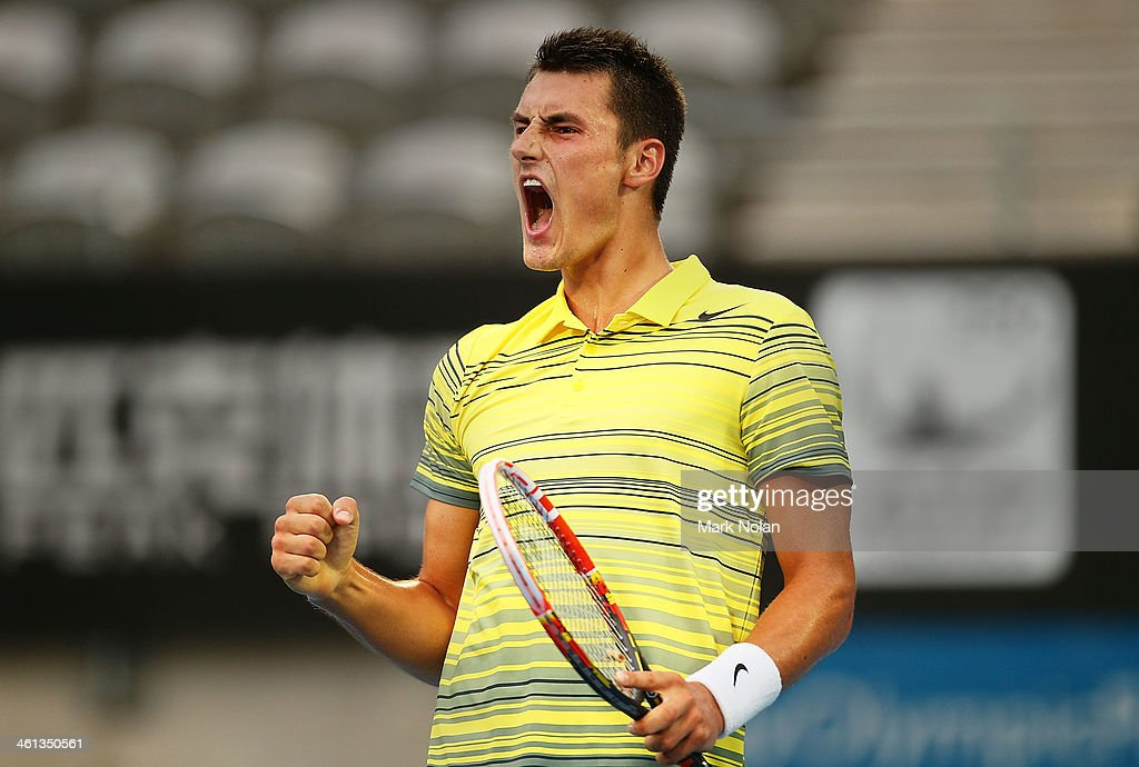 Bernard Tomic of Australia celebrates winning his match against Blaz Kavcic of Slovenia during day four of the 2014 Sydney International at Sydney Olympic Park Tennis Centre on January 8, 2014 in Sydney, Australia.