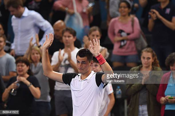 Bernard Tomic of Australia celebrates winning his match against Nicolas Mahut of France during day three of the 2016 Brisbane International at Pat...
