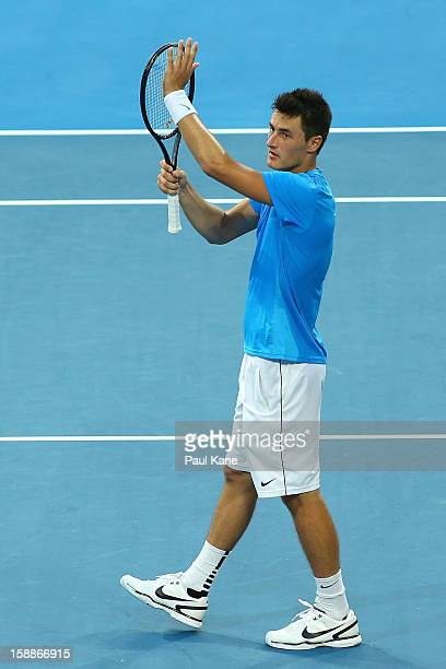 Bernard Tomic of Australia celebrates winning his singles match against Novak Djokovic of Serbia during day five of the Hopman Cup at Perth Arena on...