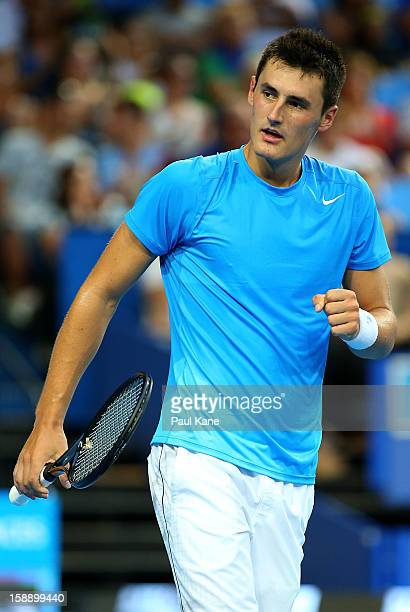 Bernard Tomic of Australia celebrates winning his singles match against Andreas Seppi of Italy during day six of the Hopman Cup at Perth Arena on...