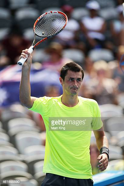 Bernard Tomic of Australia celebrates winning match point in his match against Igor Sijsling of the Netherlands during day three of the Sydney...