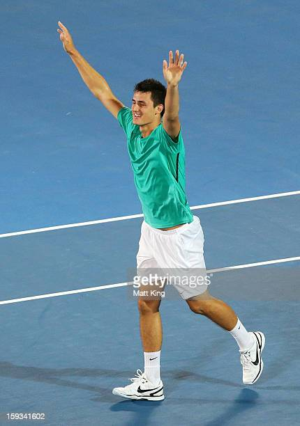 Bernard Tomic of Australia celebrates winning match point in the men's final match against Kevin Anderson of South Africa during day seven of the...