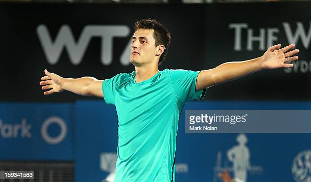 Bernard Tomic of Australia celebrates winning the Mens singles final against Kevin Anderson of South Africa during day seven of the Sydney...