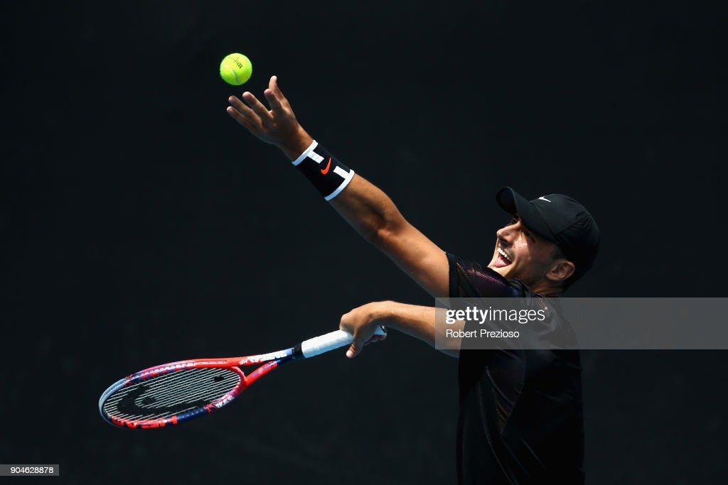 Bernard Tomic of Australia competes in his third round match against Lorenzo Sonego of Italy during 2018 Australian Open Qualifying at Melbourne Park on January 14, 2018 in Melbourne, Australia.