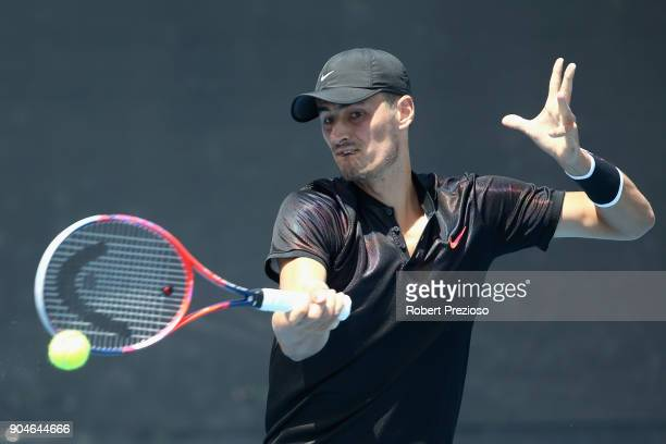Bernard Tomic of Australia competes in his third round match against Lorenzo Sonego of Italy during 2018 Australian Open Qualifying at Melbourne Park...