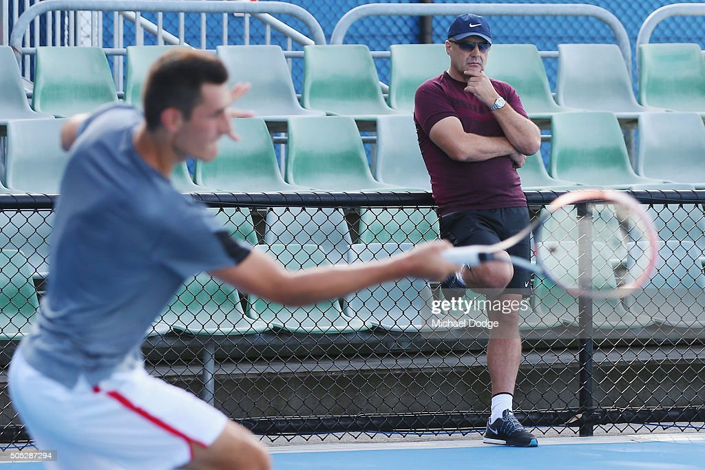 Bernard Tomic of Australia hits a forehand in front of his dad John Tomicduring a practice session ahead of the 2016 Australian Open at Melbourne Park on January 17, 2016 in Melbourne, Australia.