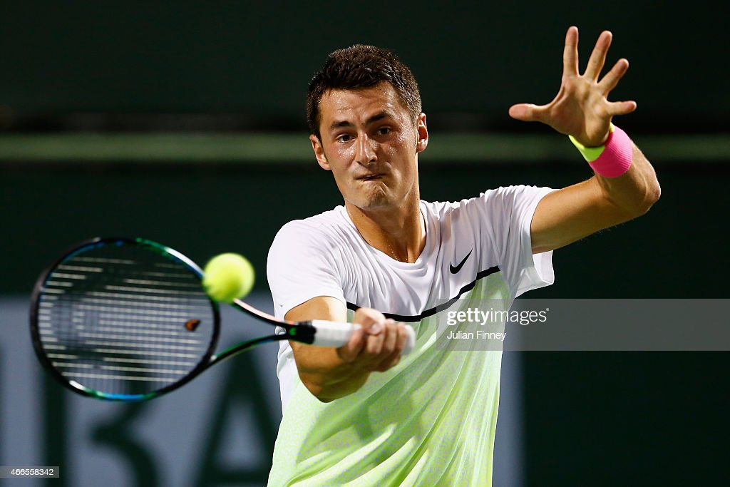 Bernard Tomic of Australia in action against David Ferrer of Spain during day eight of the BNP Paribas Open tennis at the Indian Wells Tennis Garden on March 16, 2015 in Indian Wells, California.