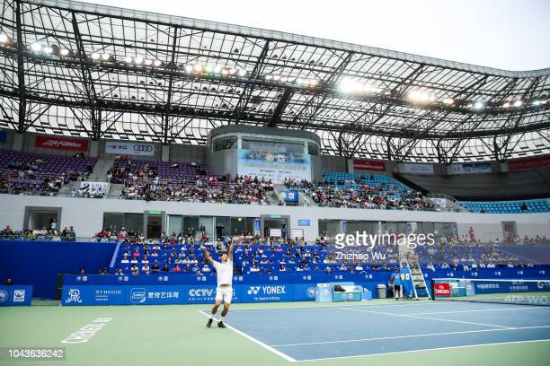 Bernard Tomic of Australia in action against Fabio Fognini of Italy during ATP World Tour Chengdu Open Men's Single Finals at Sichuan International...