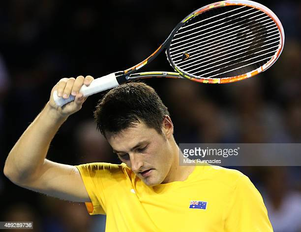 Bernard Tomic of Australia in action during his singles match against Andy Murray of Great Britain on the third day of the Davis Cup Semi Final 2015...