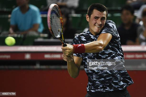 Bernard Tomic of Australia in action during the men's singles first round match against Milos Raonic of Canada on day two of Rakuten Open 2014 at...