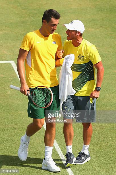 Bernard Tomic of Australia is encouraged by captain Lleyton Hewitt during his match against Jack Sock of the United States during the Davis Cup tie...