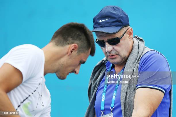 Bernard Tomic of Australia is seen with his dad John Tomic during a practice session ahead of the 2018 Australian Open at Melbourne Park on January...