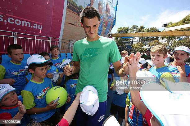 Bernard Tomic of Australia meets with ANZ Tennis Hot Shots during the 2015 Australian Open at Melbourne Park on January 24, 2015 in Melbourne,...