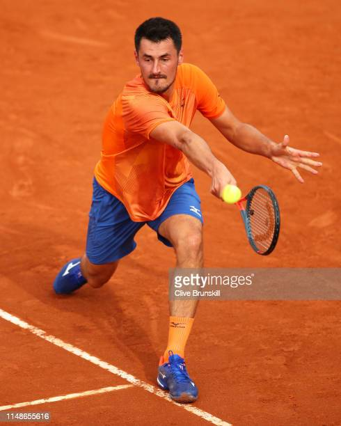 Bernard Tomic of Australia plays a backhand against Albert RamosVinolas of Spain in their final round qualifying match during day one of the...