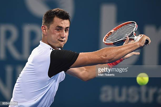 Bernard Tomic of Australia plays a backhand against Nicolas Mahut of France during day three of the 2016 Brisbane International at Pat Rafter Arena...