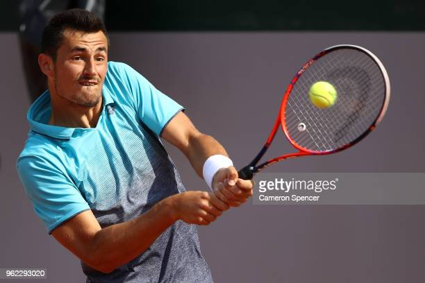 Bernard Tomic of Australia plays a backhand during his French Open third round menÕs qualifying singles match against Goncalo Oliveira of Portugal at...