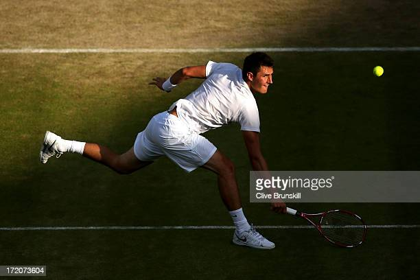 Bernard Tomic of Australia plays a backhand during the Gentlemen's Singles fourth round match against Tomas Berdych of Czech Republic on day seven of...