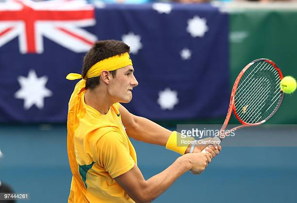 Bernard Tomic of Australia plays a backhand in his match against TsungHua Yang of Chinese Taipei during day of the Davis Cup AsiaOceania Zone Group 1...
