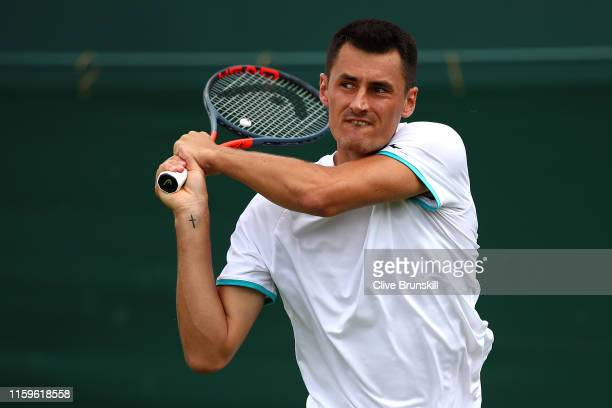 Bernard Tomic of Australia plays a backhand in his Men's Singles first round match against JoWilfred Tsonga of France during Day two of The...