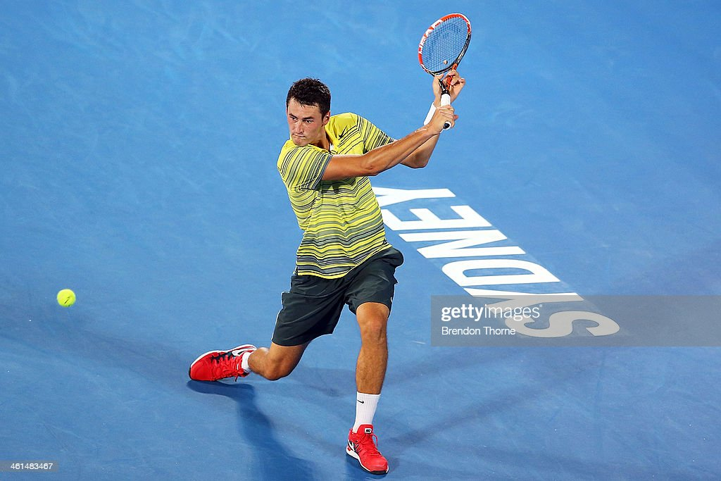 Bernard Tomic of Australia plays a backhand in his quarter final match against Alexandr Dolgopolov of the Ukraine during day five of the 2014 Sydney International at Sydney Olympic Park Tennis Centre on January 9, 2014 in Sydney, Australia.