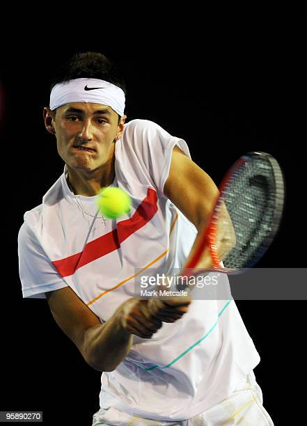 Bernard Tomic of Australia plays a backhand in his second round match against Marin Cilic of Croatia during day three of the 2010 Australian Open at...