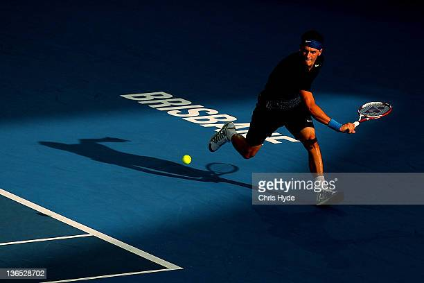 Bernard Tomic of Australia plays a backhand in his semi final match against Andy Murray of Great Britain during day seven of the 2012 Brisbane...