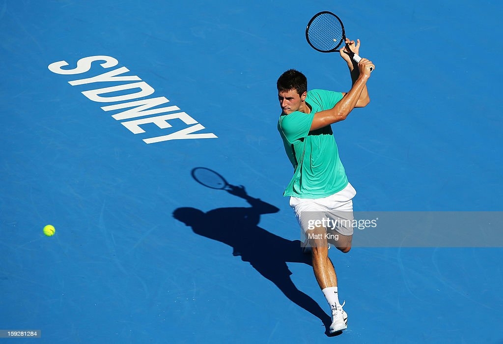 Bernard Tomic of Australia plays a backhand in his semi final match against Andreas Seppi of Italy during day six of the Sydney International at Sydney Olympic Park Tennis Centre on January 11, 2013 in Sydney, Australia.
